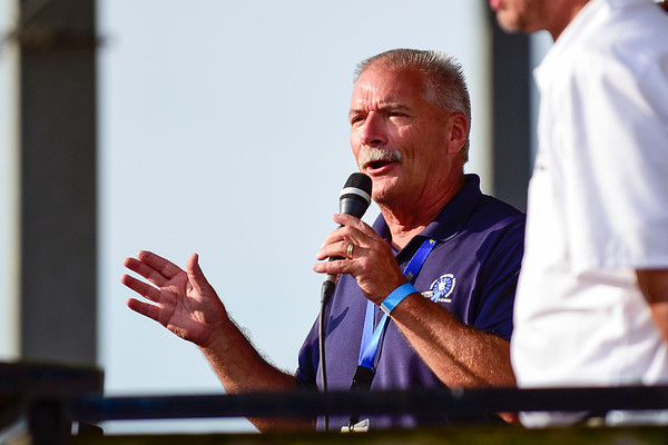 BEN MIKESELL   THE GOSHEN NEWS<br /> Fair president Mark Kritzman speaks to the crowd gathered in the grandstands before the Sarge & Son's Demolition Derby Saturday evening at the Elkhart County 4-H Fair.