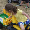 LIZ RIETH | THE GOSHEN NEWS <br /> Bella Smith, 6, chooses food for the Farm to Market Driving Course. The course teaches children where food comes from.