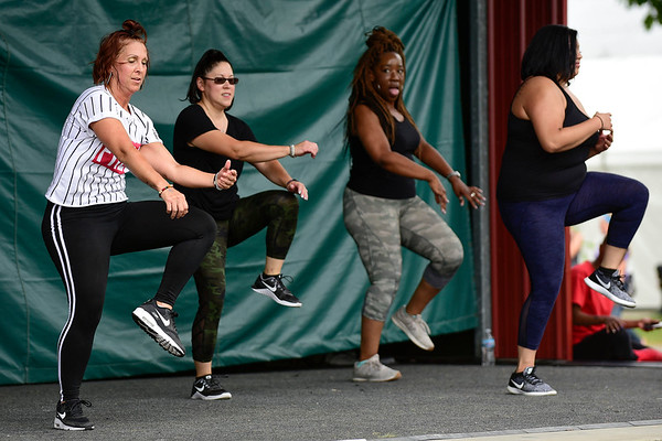 BEN MIKESELL | THE GOSHEN NEWS<br /> Members of Inferno Studio in Elkhart perform at the Elkhart County 4-H Fair to celebrate National Dance Day Saturday at Heritage Park Stage.