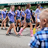 BEN MIKESELL | THE GOSHEN NEWS<br /> Participants in the Fair Queen Pageant wave to the crowd during the 2018 4-H Fair Parade Sunday in downtown Goshen.