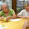 BEN MIKESELL | THE GOSHEN NEWS<br /> Vi Miller, left, of Goshen, peels an apple with her granddaughter Raina Carpenter, Goshen, during the apple peel contest Tuesday morning at the Home and Family Arts Building. Miller, an apple peeling veteran, reached 57 inches, while Carpenter reached 15.