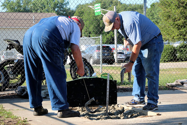LIZ RIETH | THE GOSHEN NEWS Keith Burger, Syracuse, and Lester Krull pick up their horseshoes at the Horseshoe Pitching Contest Wednesday.