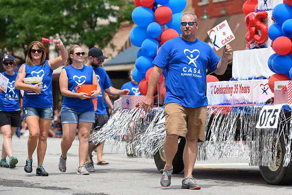 BEN MIKESELL | THE GOSHEN NEWS<br /> Members of the Elkhart County CASA Program walk down Main Street during the 2018 4-H Fair Parade Sunday in downtown Goshen.