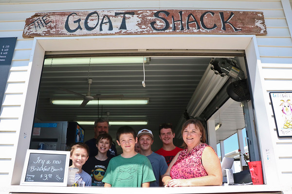 LEANDRA BEABOUT | THE GOSHEN NEWS<br /> A group of volunteers stands in the window of the Goat Shack Wednesday afternoon at the Elkhart County 4-H Fair. Tina Weaver, front right, is the manager.