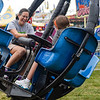 "BEN MIKESELL | THE GOSHEN NEWS<br /> Carrie Norris of Goshen laughs with her daughter Hannah, 14, while on the Tornado ride early Monday morning for Disability Day at the Elkhart County 4-H Fair. ""My daughter has epilepsy, and we look forward to this day every year,"" Norris said. Sounds and lights on rides were turned off to accomodate the riders for Disability Day."