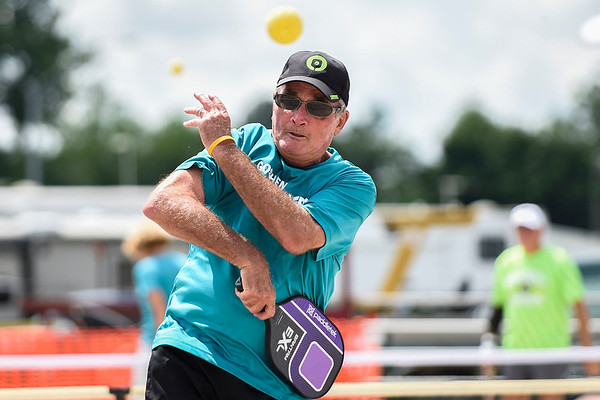 BEN MIKESELL | THE GOSHEN NEWS<br /> George Dyer of Elkhart sends a ball over the net during a pickleball tournament Tuesday at the Elkhart County 4-H Fair.