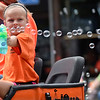 BEN MIKESELL | THE GOSHEN NEWS<br /> A girl with Roberts Farms blows bubbles during the 2018 4-H Fair Parade Sunday in downtown Goshen.