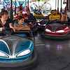 BEN MIKESELL | THE GOSHEN NEWS<br /> Fair-goers enjoy a round of bumper cars early Monday morning at the Elkhart County 4-H Fair for Disability Day.