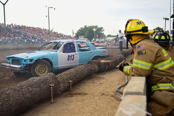 BEN MIKESELL | THE GOSHEN NEWS<br /> Firefighters from across Elkhart County wait along the sidelines during Saturday night's demolition derby at the Elkhart County 4-H Fair.