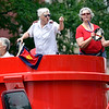 BEN MIKESELL | THE GOSHEN NEWS<br /> Members of the Salvation Army dance with tambourines during the 2018 4-H Fair Parade Sunday in downtown Goshen.