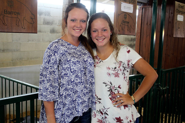 LIZ RIETH | THE GOSHEN NEWS Sisters Courtney, left and Macy, 14, Lengacher won grand champion and reserve champion for swine Wednesday.