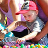 LEANDRA BEABOUT | THE GOSHEN NEWS<br /> Raiden Taylor, 2, Goshen, reaches for a plastic egg to fill during Kid's Day at the Elkhart County 4-H Fair.