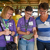 BEN MIKESELL | THE GOSHEN NEWS<br /> Judges Regina Goodman, Sue Perri and Barbara Toole, all from Goshen, listen with their backs turned for the best chicken imitations Tuesday morning at the Poultry Barn.