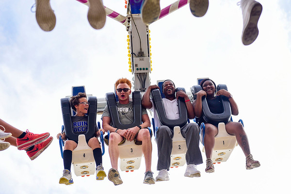 BEN MIKESELL | THE GOSHEN NEWS<br /> Fairgoers take a ride on the Freak Out Saturday afternoon at the Elkhart County 4-H Fair.