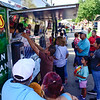 BEN MIKESELL | THE GOSHEN NEWS<br /> Fair attendees order food from Javi's food truck prior to Latino Night festivities Friday at Heritage Park.