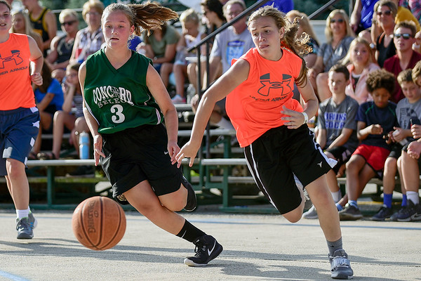 BEN MIKESELL | THE GOSHEN NEWS<br /> Concord Select's Aliyah Hershberger, 13, chases a loose ball with Mariah Stoltzfus, 13, on Team Cross during Thursday's 13-15 girls semifinals game at the Elkhart County 4-H Fair.