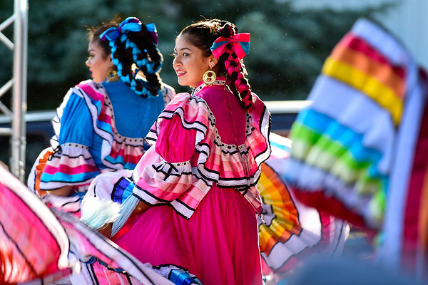 BEN MIKESELL | THE GOSHEN NEWS<br /> Ruvy Delgato, 15, of South Bend, dances on stage during Friday's Latino Night at Heritage Park. La Raza radio sponsored Friday night's festivities.
