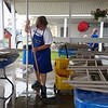 TERRAH HARMON | THE GOSHEN NEWS<br /> Janet Buccione, Goshen, mops the floor on Sunday, July 22, as she prepares for fair goers.