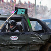 BEN MIKESELL | THE GOSHEN NEWS<br /> Justice Bishop, of Elkhart, competes in the powder puff division of Saturday night's demolition derby at the Elkhart County 4-H Fair.