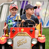 BEN MIKESELL | THE GOSHEN NEWS<br /> Holden Court, 3, left, and his brother Cael, 7, of Goshen, take a spin on the fire chief amusement ride Tuesday afternoon at the Elkhart County 4-H Fair.