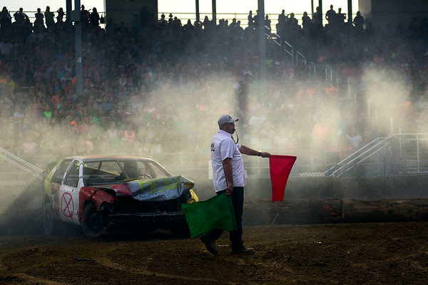 BEN MIKESELL | THE GOSHEN NEWS<br /> The red flag is waved at the conclusion of the wire-up division round of Saturday night's demolition derby at the Elkhart County 4-H Fair.