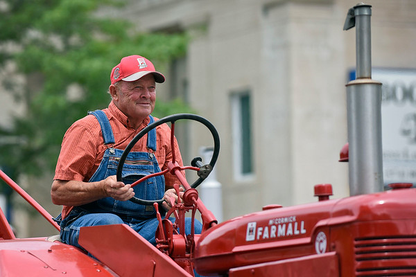 BEN MIKESELL | THE GOSHEN NEWS<br /> Lester Graber, Goshen, drives his tractor down Main Street during the 2018 4-H Fair Parade Sunday in downtown Goshen.