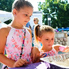 LEANDRA BEABOUT | THE GOSHEN NEWS<br /> Sisters Delaney Garrett, 7, and Aubrey Garrett, 4, both of Goshen, fill an egg with rice at a music station set up for Kid's Day at the Elkhart County 4-H Fair.