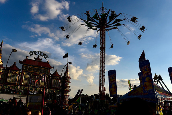 BEN MIKESELL | THE GOSHEN NEWS<br /> Fair-goers enjoy amusement rides Thursday evening at the Elkhart County 4-H Fair.