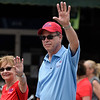 BEN MIKESELL | THE GOSHEN NEWS<br /> Republican Senate nominee Mike Braun waves to the crowd while walking down Main Street during the 2018 4-H Fair Parade Sunday in downtown Goshen.