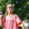 LEANDRA BEABOUT | THE GOSHEN NEWS<br /> Avery Runge, 11, Nappanee, prepares to throw a beanbag during Kid's Day at the Elkhart County 4-H Fair.