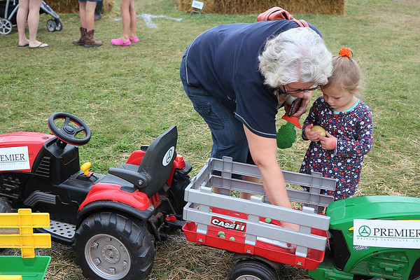 LIZ RIETH | THE GOSHEN NEWS<br /> Patsy Pealer, Dunlap, and granddaughter Sloane Espinas, 3, choose food for the Farm to Market Driving Course. The course teaches children where food comes from.