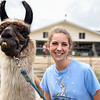 BEN MIKESELL | THE GOSHEN NEWS<br /> Halee Fisher, 17, of Millersburg, stands with Ulani, an 11-year-old heavy wool llama outside the 4-H Llama Club tent Monday at the Elkhart County 4-H Fair. Fisher has worked in the club for five years and won third place in showmanship this year.