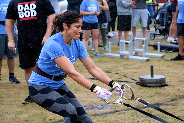 LIZ RIETH   THE GOSHEN NEWS Bertha Luna, Elkhart, strains at the yolk and sled drag event in the Elkhart County 4-H Fair Strongman Competition Saturday.