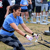 LIZ RIETH | THE GOSHEN NEWS Bertha Luna, Elkhart, strains at the yolk and sled drag event in the Elkhart County 4-H Fair Strongman Competition Saturday.