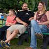 BEN MIKESELL | THE GOSHEN NEWS<br /> Conner Smith, 10, with his parents Fount and Bridget Smith, of Goshen, sit on a bench outside Heritage Park Monday at the Elkhart County Fairgrounds.