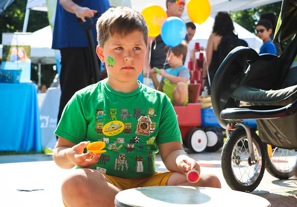 LEANDRA BEABOUT   THE GOSHEN NEWS<br /> William Herr, 7, Nappanee, plays the drum during Kid's Day at the Elkhart County 4-H Fair.