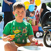 LEANDRA BEABOUT | THE GOSHEN NEWS<br /> William Herr, 7, Nappanee, plays the drum during Kid's Day at the Elkhart County 4-H Fair.