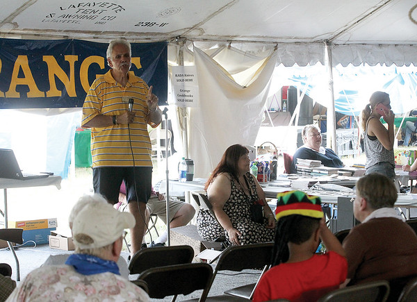 Fred Capozzi, former Chief of Police for the Seneca Falls Police Department, spoke to the audience at the Grange tent at the Empire Farm Days Wednesday.