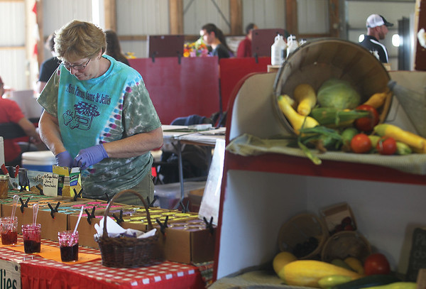 Noreen Whitney of Branchport and Nordic Farms Jams & Jellies works at her stand that was selling homemade items.