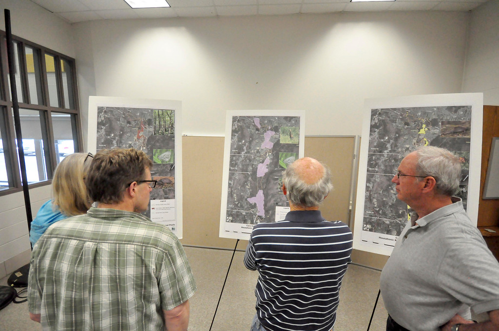 . People look at some poster boards that outline the proposed PCB clean up of the Housatonic River prior to a meeting at Lenox Memorial Middle and High School on East Street on Wednesday, June, 18, 2014. Gillian Jones / Berkshire Eagle Staff / photos.berkshireeagle.com