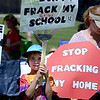 "Will Gellatly, 7, attends Red Hawk Elementary, which is near the drilling site.<br /> Scores of concerned citizens  gathered in Erie Community Park on Saturday to protest fracking in Erie, CO, by the  Encana Corp.<br /> For more photos and a video of the event, go to  <a href=""http://www.dailycamera.com"">http://www.dailycamera.com</a>.<br /> Cliff Grassmick / June 2, 2012"