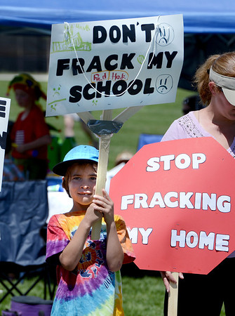 """Will Gellatly, 7, attends Red Hawk Elementary, which is near the drilling site.<br /> Scores of concerned citizens  gathered in Erie Community Park on Saturday to protest fracking in Erie, CO, by the  Encana Corp.<br /> For more photos and a video of the event, go to  <a href=""""http://www.dailycamera.com"""">http://www.dailycamera.com</a>.<br /> Cliff Grassmick / June 2, 2012"""