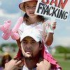 "Daniel Roy has his daughter, Lyzelle, 4, on his shoulders, while listening to the speakers at the rally.<br /> Scores of concerned citizens  gathered in Erie Community Park on Saturday to protest fracking in Erie, CO, by the  Encana Corp.<br /> For more photos and a video of the event, go to  <a href=""http://www.dailycamera.com"">http://www.dailycamera.com</a>.<br /> Cliff Grassmick / June 2, 2012"