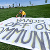 "Elliot Caile makes a painted hand print on the protest sign before the march.<br /> Scores of concerned citizens  gathered in Erie Community Park on Saturday to protest fracking in Erie, CO, by the  Encana Corp.<br /> For more photos and a video of the event, go to  <a href=""http://www.dailycamera.com"">http://www.dailycamera.com</a>.<br /> Cliff Grassmick / June 2, 2012"