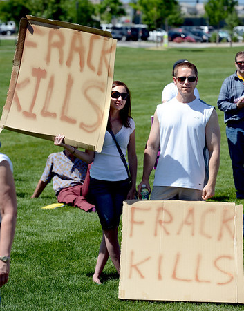 "Amy Grossman, left, and Dave Auerbach, get to the point with their fracking feelings.<br /> Scores of concerned citizens  gathered in Erie Community Park on Saturday to protest fracking in Erie, CO, by the  Encana Corp.<br /> For more photos and a video of the event, go to  <a href=""http://www.dailycamera.com"">http://www.dailycamera.com</a>.<br /> Cliff Grassmick / June 2, 2012"