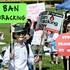"Jeff Olson holds up two signs in protest of fracking.<br /> Scores of concerned citizens  gathered in Erie Community Park on Saturday to protest fracking in Erie, CO, by the  Encana Corp.<br /> For more photos and a video of the event, go to  <a href=""http://www.dailycamera.com"">http://www.dailycamera.com</a>.<br /> Cliff Grassmick / June 2, 2012"