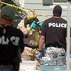 """Authorities remove and test materials at the home.<br /> Law enforcement and fire/rescue officers from around Boulder County responded to a  meth lab clean up on Bonanza Dr. in Erie on Friday. For a video of the scene, go to  <a href=""""http://www.dailycamera.com"""">http://www.dailycamera.com</a>.<br /> Cliff Grassmick / September 3, 2010"""