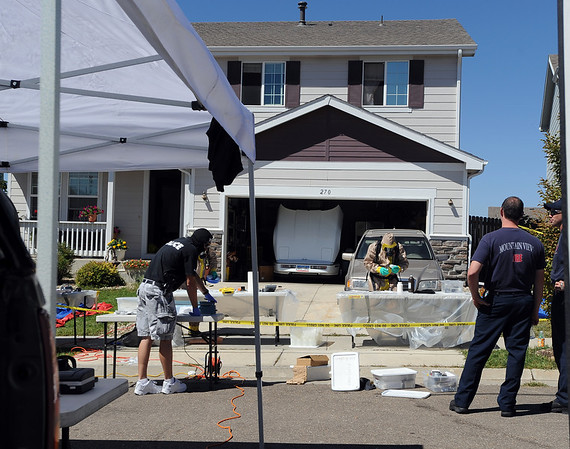 "Law enforcement and fire/rescue officers from around Boulder County responded to a  meth lab clean up on Bonanza Dr. in Erie on Friday. For a video of the scene, go to  <a href=""http://www.dailycamera.com"">http://www.dailycamera.com</a>.<br /> Cliff Grassmick / September 3, 2010"
