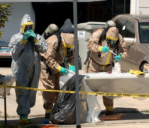"Authorities remove and test materials at the meth lab home.<br /> Law enforcement and fire/rescue officers from around Boulder County responded to a  meth lab clean up on Bonanza Dr. in Erie on Friday. For a video of the scene, go to  <a href=""http://www.dailycamera.com"">http://www.dailycamera.com</a>.<br /> Cliff Grassmick / September 3, 2010"