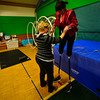 "KRISTOPHER RADDER - BRATTLEBORO REFORMER<br /> Aimee Hancock, director of the New England Center for Circus Arts' show, ""The Flying Nut 2016: Bratt in Bayou,"" helps Erin Ball put on her stilts on Tuesday, Dec. 13, 2016."